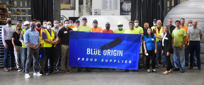Team Spincraft holding the Blue Origin Proud Supplier Flag